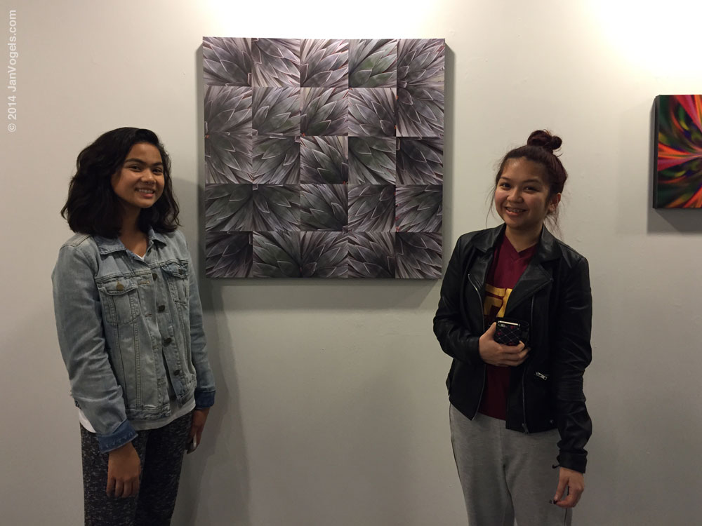 Several high school students stopped by to ask questions about the how and why of some of the canvases.